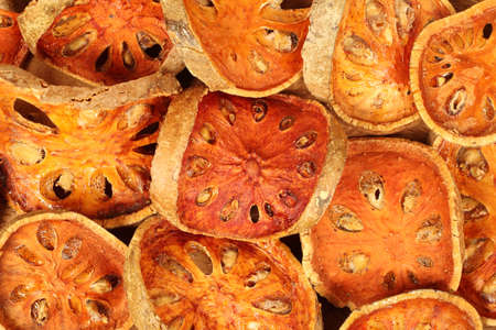 Background of slices dried bael fruit.