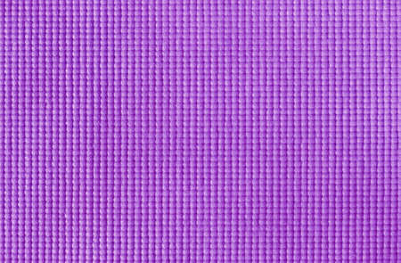 Texture of purple color yoga mat for background and design art work.