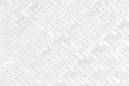 White bamboo weaving pattern, old woven rattan mat texture for background and design art work.