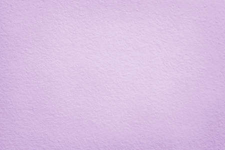 Light purple cement concrete wall texture for background and design art work. 免版税图像