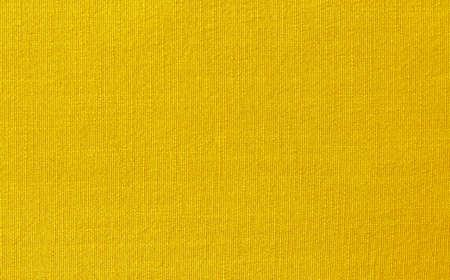Yellow cotton fabric texture background, seamless pattern of natural textile. 免版税图像