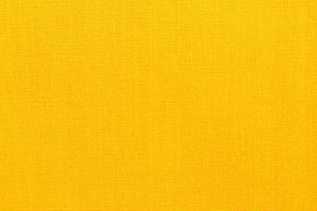 Yellow linen fabric texture background, seamless pattern of natural textile.