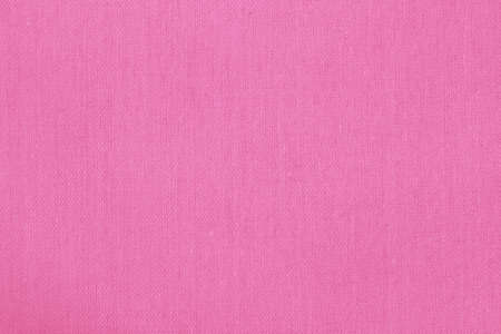 Pink cotton fabric texture background, seamless pattern of natural textile.
