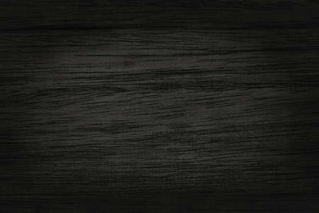 Black wooden wall background, texture of dark bark wood with old natural pattern for design art work, top view of grain timber. Imagens