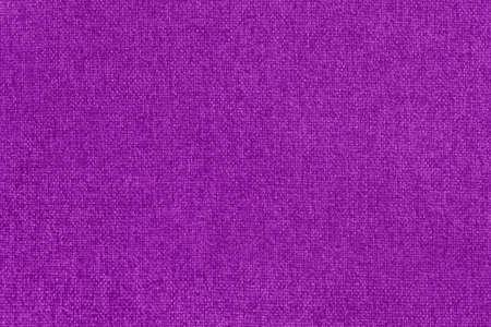 Dark purple cotton fabric texture background, seamless pattern of natural textile.