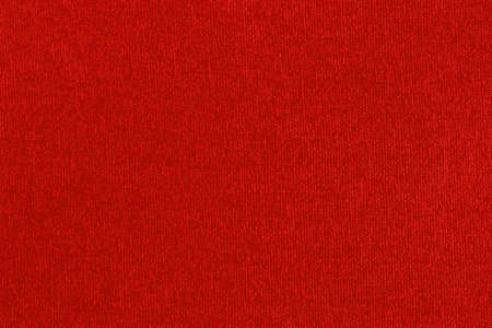 Dark red fabric texture background, seamless pattern of natural textile surface.