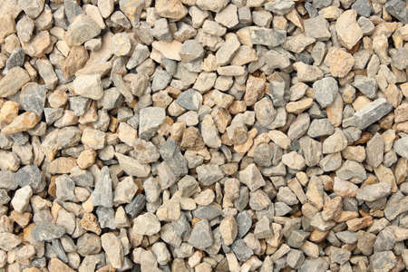 Close up of gravel in the garden, natural small stones texture for background and design art work. Imagens