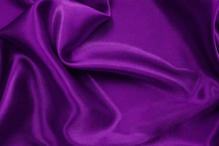 Purple fabric cloth texture for background and design art work, beautiful crumpled pattern of silk or linen. Imagens