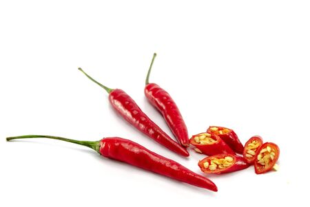 Closeup of red chili pepper, sliced on white background, raw food ingredient concept with isolated
