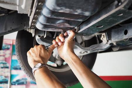 auto repair: Mechanic working in auto repair garage. Car maintenance