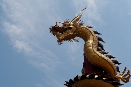Dragon statue on blue sky backgroung Stock Photo