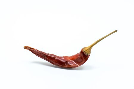 Drie chilli on white background