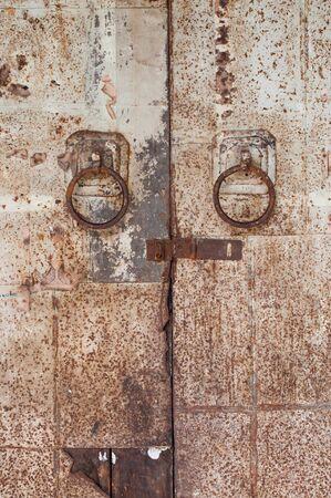 steel door: Old galvanized steel door handles