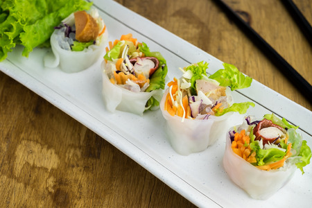 cuon: Portion of spring rolls , vegetables and in noodle tube