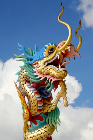 Chinese dragon statue with the sky photo
