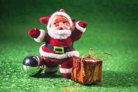 Santa Claus with gifts box on green background. Stock Photo - 16562913