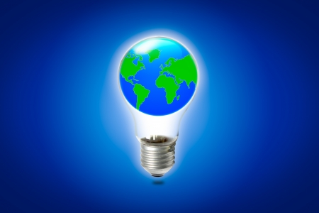 World in light bulb on blue background photo