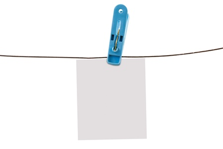 Clothing pin and wire with white paper isolated on white photo