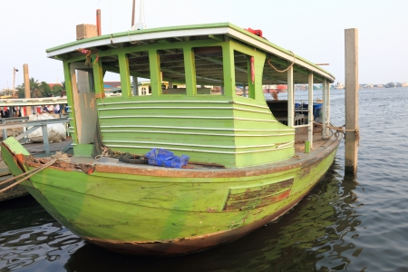 green boat: Old wooden green boat