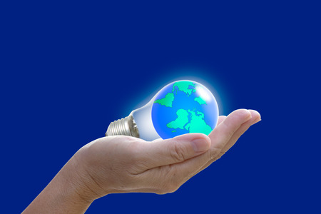 abstract globe in the light bulb, protect our world, save the earth photo