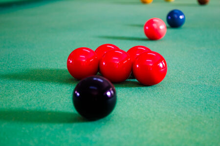 snooker balls: Colorful of snooker balls on green pool table.