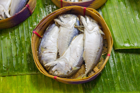 Mackerel fish in bamboo basket. photo