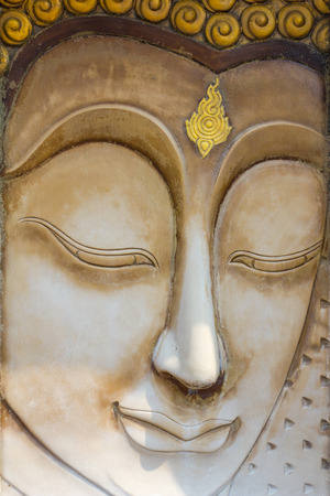 low relief: buddha face sculpture