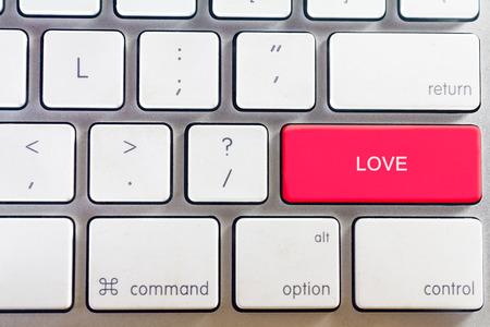 White keyboard and love button Archivio Fotografico