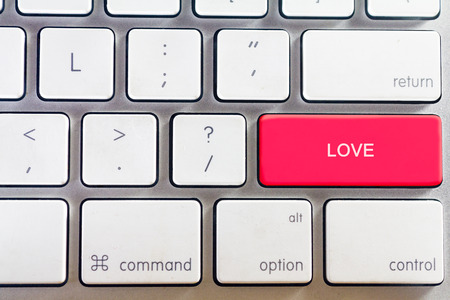 White keyboard and love button Standard-Bild