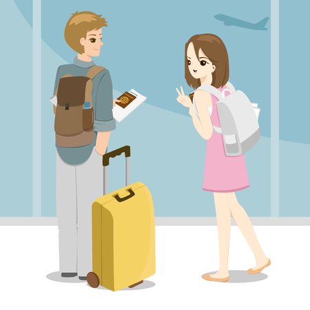 happy young couple with bags at airport and holding passport in hand
