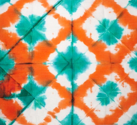 Abstract tie dyed fabric background photo