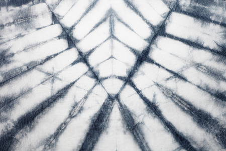 indigo: Abstract tie dyed fabric background