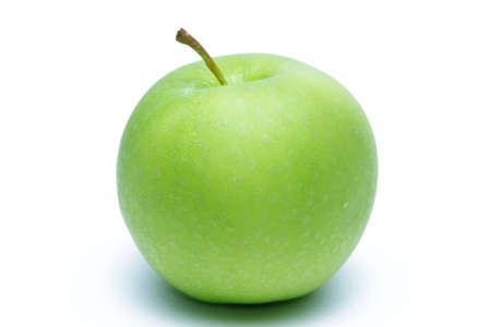 Green apple with dew on white background Stock Photo