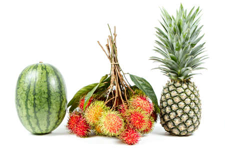 Watermelon, rambutan and pineapple isolated on white background.