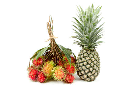Pineapple and rambutan  isolated on white background.