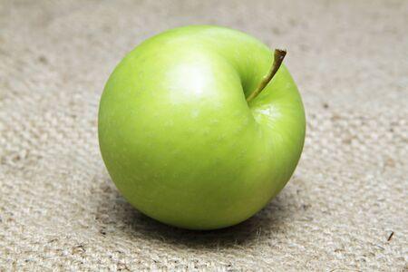 apple sack: Green apple on sack. Stock Photo