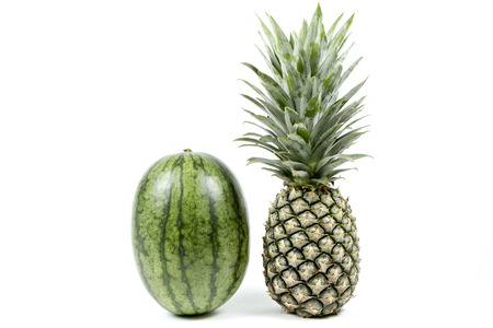Watermelon and pineapple isolated on white background.