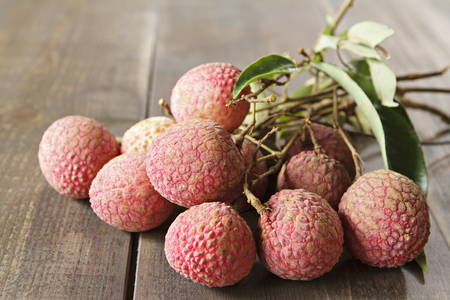 lychees: Fresh lychees on wooden. Stock Photo