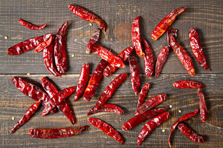 Dried chili on wooden background.