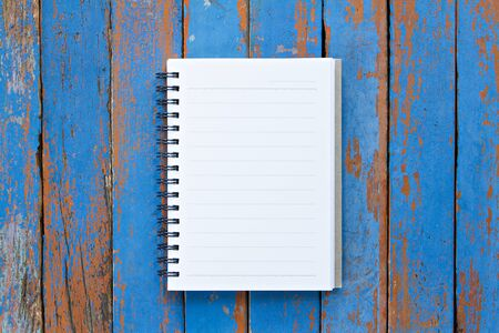 Page of notebook on wooden background