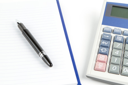 Notebook with black pen and calculator Stock Photo