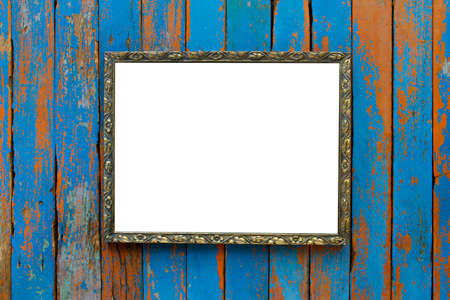 Old wooden picture frame on wooden background