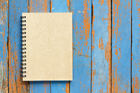 Brown notebook on wooden background