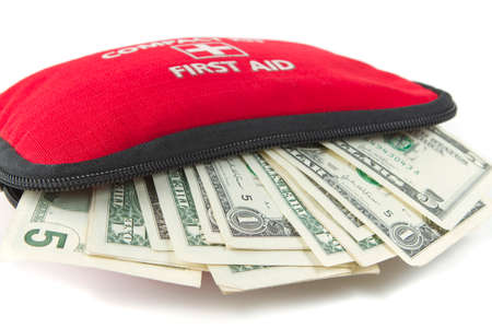 First aid kit with dollar. Stock Photo