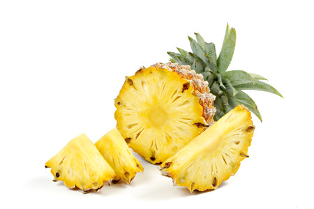 Pineapple with slices on  white background.