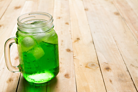Jar of sweet drink on wooden table. Stock Photo
