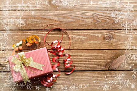 snow crystal: Christmas presents with snow crystal on wooden table background.