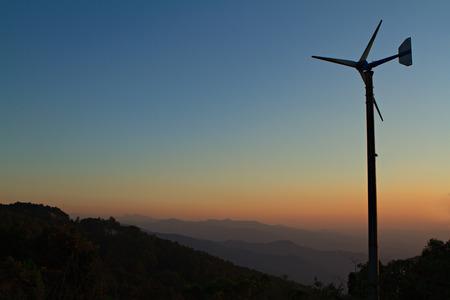 conservation: Wind turbines at sunset