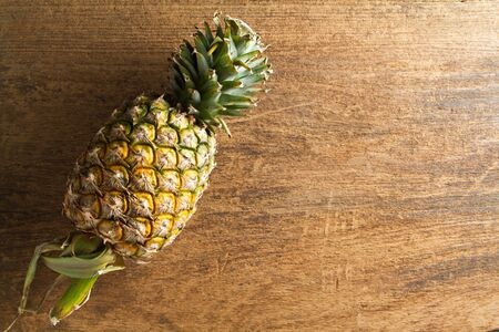 Pineapple on wooden background.