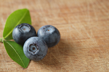 Blueberries on wooden. Blueberry contain antioxidant organic  useful healthy and nutrition. Zdjęcie Seryjne